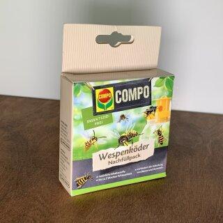 Compo Wespenköder Nachfüllpack auf Holzbrett.
