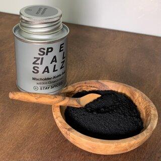 Wacholder Kohle Salz in Olivenholzschüssel.